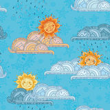Smiling sun, clouds and rain on blue background Royalty Free Stock Images