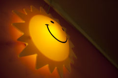 Smiling sun face lamp Stock Photo