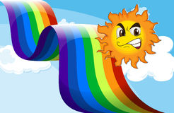 A smiling sun near the rainbow Royalty Free Stock Photography