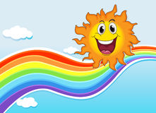 A smiling sun near the rainbow Royalty Free Stock Image