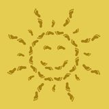Smiling sun from traces on sand. The abstract image: a smiling sun from traces on sand Royalty Free Stock Image