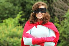 Smiling super hero girl Stock Photo