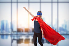 Smiling superhero female raised her hand up. Royalty Free Stock Images