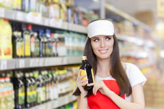 Smiling Supermarket Employee Holding a Product Stock Photography