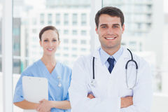 Smiling surgeon and doctor posing together Stock Photo