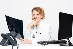 Smiling surgeon holding x-ray report Stock Photos