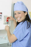 Smiling surgeon making drink Stock Images