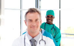 Smiling surgeon in a row Stock Photo