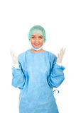 Smiling surgeon showing hands in gloves stock photo