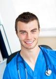Smiling surgeon smiling and wearing scrubs Royalty Free Stock Image