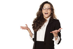 Smiling surprise. Smiling and surprised girl in glasses on white background Stock Photography