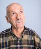 Smiling surprised senior man Stock Image