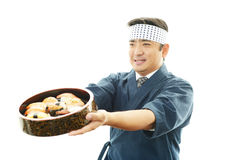 Smiling sushi chef Stock Photo
