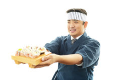 Smiling sushi chef Stock Images