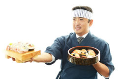 Smiling sushi chef Stock Photography