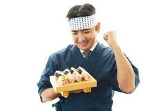 Smiling sushi chef Royalty Free Stock Photos
