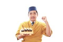 Smiling sushi chef Stock Photo