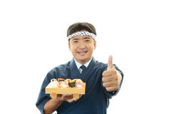 Smiling sushi chef with thumbs up Royalty Free Stock Images