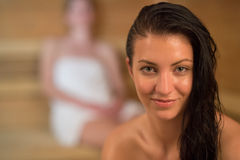 Smiling sweaty woman in the sauna Stock Images