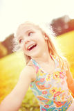 Smiling sweet little girl. Doing a selfie on a sunny day stock images