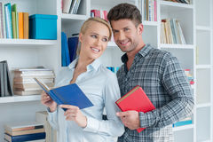 Smiling Sweet Partners Posing at Mini Library Royalty Free Stock Image