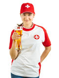 Smiling Swiss sports fan. Photo of a Swiss sports fans holding a beer and cheering for her team isolated over white background Stock Photo