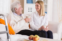 Smiling, talking and drinking tea Royalty Free Stock Photos
