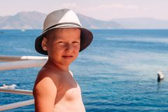 Smiling tanned baby on the sea royalty free stock photos