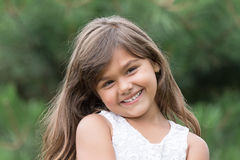 Smiling tanned brunette little girl royalty free stock image