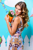 Smiling tanned girl. Summer fashion. Happy tanned girl posing in summer decoration. Beauty, fashion Stock Image
