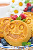 Smiling tasty corn pancake with berries Royalty Free Stock Photo