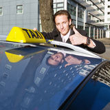 Smiling taxi driver Stock Image