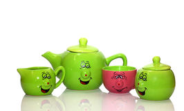 Smiling tea-set Stock Images