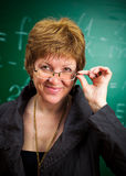 Smiling teacher with glasses Stock Photo