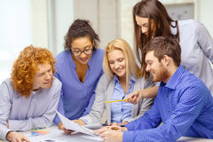 Smiling team with color samples at office Royalty Free Stock Photography