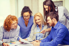 Smiling team with color samples at office Royalty Free Stock Photos