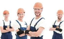 Smiling team of construction workers . Photo with copy space royalty free stock image