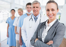 Smiling team of doctors standing in line Stock Photography