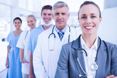 Smiling team of doctors standing in line Royalty Free Stock Photo