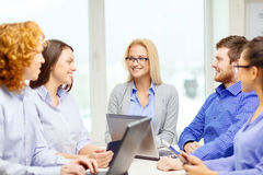 Smiling team with laptop and table pc computers Royalty Free Stock Photography