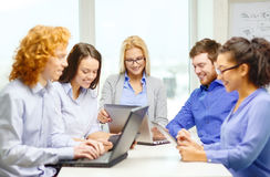 Smiling team with laptop and table pc computers Stock Photography