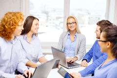 Smiling team with laptop and table pc computers Stock Photo