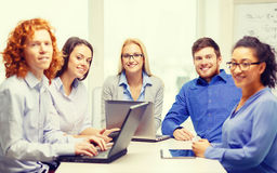 Smiling team with laptop and table pc computers Stock Images