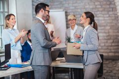 Team leader executive introducing new just hired female employee to colleagues royalty free stock photo