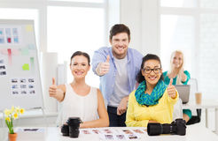 Smiling team with photocamera in office Royalty Free Stock Photography