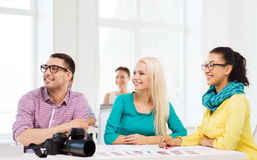Smiling team with photocamera working in office Stock Images