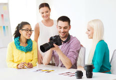 Smiling team with photocamera working in office Royalty Free Stock Photography