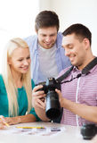 Smiling team with photocamera working in office Royalty Free Stock Image