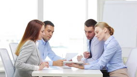 Smiling team with table pc and papers working stock footage