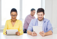 Smiling team with tablet pc computers at office Stock Photos